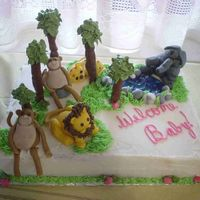 Jungle Baby Shower Cake Buttercream Cake with Gumpaste jungle animals, trees are tootsie rolls stacked on a bamboo skewer and leaves were buttercream. I had a lot...