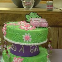 "Zoee's Baby Shower 7/07 This was chocolate cake done in an 8' and 9"" pans. A spur of the moment cake. I was out of BC so had to use store bought icing..."