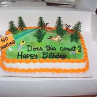 "Randy's Hunting Cake  I made this for my friend who is a logger. He also enjoys hunting, but wasnt able to do so this past year. Notice the sign says ""no..."