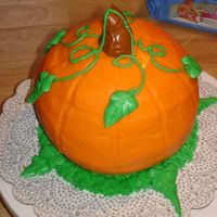 Pumpkin Cake #2 This is a collaborative effort between my husband and I. This was for a Halloween cake walk in 2007.