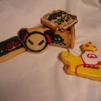 Birthday Cookies. I packed these cookies up with the Beatles birthday cake... Pucca, a controller, a Space Invaders box, and the yellow submarine.