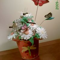 Dragonfly chocolate and vanilla cupcakes with strawberry filling, Dragonflies, butterflies and daisies are fondant,