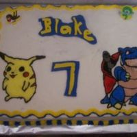 Pokemon Cake  I made this cake for my grandson's 7th birthday. Pikachu and Blastoise. They are buttercream transfers which I really don't like...