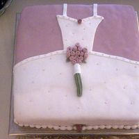 Wedding Gown Cake  This is a 20 inch square White Sour Cream Cake with Fresh Strawberries and cream filling. All Satin Ice fondant. I made this for my sister...