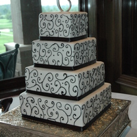 Black Scroll   All buttercream with the exception of the ribbon around the bottom.