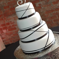 "Black Ribbon   Fondant covered - with black ribbon wrapped around it. Topper was ""jeweled"". I liked the way it turned out!"