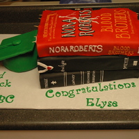 "Books For Graduation Three books that the graduating girl really likes, Bible, Twilight and Nora Roberts. There are toothpicks under the top book to ""hold&..."