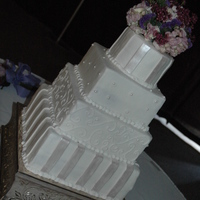 Wedding Cake - Buttercream With Fondant Accents All buttercream with fondant accents. Fresh flowers on top!