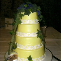 A Little Of Yellow cake covered in fondant with real floral and burlap ribbon