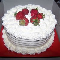 Strawberries And Cream Cake Vanilla cake with strawberry preserves and fresh strawberry filling. Covered with stabilized whipped cream frosting with fresh strawberry...