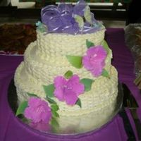 Basket Weave With Gumpaste Hibiscus Flowers I did this for a cake for a 50th birthday party. The cake was lemon with pineapple manderin orange filling. I iced it in buttercream. It...