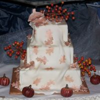 Fall Themed Wedding Cake   This is a dummy cake I did for a bridal show. all is fondant with leaf imprints in fondant colored with luster dust.
