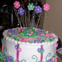 Flower Birthday Cake A client of mine wanted something fun for her daughters birthday and she was inspired by a cake in the wilton yearbook. So here is my...