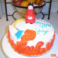 Joey's 4Th Birthday Cake  This is a white cake with chocolate sprinkles to resemble a dalmation. The fireman and hose are all made of fonadant, the nozzle is fondant...