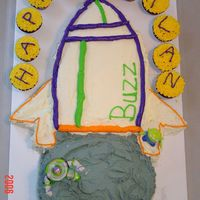 Buzz Lightyear  This is a cake I made for my son's 4th birthday. The space ship is silver white cake (my mom made this for my 4th bday) with...