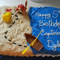Captain Dylan's Treasure Map  I made this cake for my son's 5th birthday. He requested a chocolate and strawberry layers with buttercream icing. The saned is a...