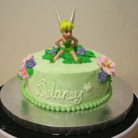 "Baby's First Birthday 6"" tinkerbell cake made just for the birthday girl. Couldn't get the buttercream completely smooth but I don't think she&#..."