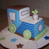 Toy Train Baby Shower Cake This cake was designed to match the baby shower invitation and party room decor.