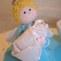 Angel And Baby Fondant+gumtex hand molded angel and baby for a baptism cake.