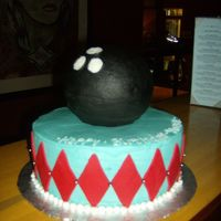 Bowling Party   The cake and the ball was covered in buttercream, the red diamond shapes were cut from fondant.