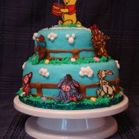 Winnie The Pooh The cake of firsts! My first time working with marshmallow fondant, making a tiered cake, & working with chocolate transfers (love them...