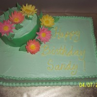Sandys Birthday Cake choc cake w/ strawberry cream filling. Fondant daisies