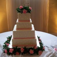 Kindra's Wedding Cake Four square stacked cakes. 14, 12 and 8, 6 inches. This was my first time using my 2 inch pans...and I LOVE THEM!!! My cakes were almost 5...