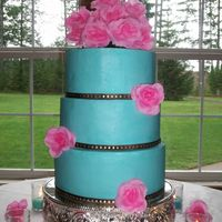 Blue And Pink Wedding This is a 10, 9 and 8 inch stacked cake with BC icing. The pink flowers are silk