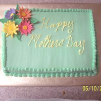 Mother's Day Cake I made this cake for my ma good thing too cause I just realized I forget the apostrophe on mother's :) It was a lemon cake w/ rasp...