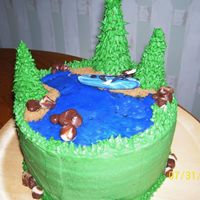Kayaking Cake A birthday cake for my DH, four layer chocolate with mint cream filling, buttercream with candy clay accents.