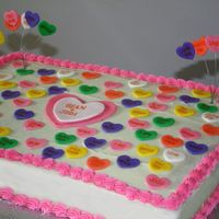 Conversation Heart Cake Cherry Chip sheet cake with buttercream frosting and fondant conversation hearts.