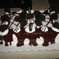 Cookies-N-Cream Cookies-n-creme cake with buttercream icing and chocolate ganache.