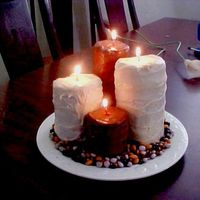 Burning Candles These are some candles I made for a candle party. I rolled the cake like a jelly roll, covered the cakes with chocolate candy melts. I used...