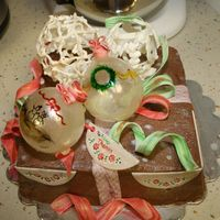 Ornament Cake I made this cake as a christmas present for a friend. It is a chocolate cake filled and covered in chocolate mousse. There are blown sugar...