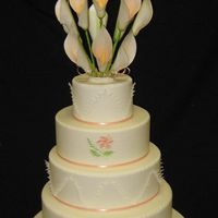 Calla Lily Wedding Cake As the final practical for my Wedding Cake class I had to make a wedding cake. The cake is actually a dummy cake which is styrofoam. the...