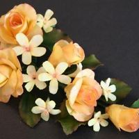 Tea Rose Spray Here is a spray of gumpaste tea roses and blossoms along with rose leaves.