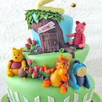 Whimsical Topsy Turvy Pooh & Friends Cake