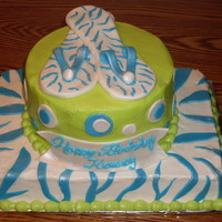 Blue And Green Birthday Cake This one is iced in buttercream with fondant accents. Customer wanted blue and green colors, got the idea for blue zebra stripes from this...