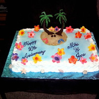 Hawiian Theme full sheet cake with royal icing flowers and chocolate transfers