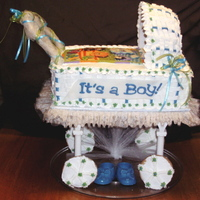 Precious Planet Baby Carriage 1/3 sheet double layer cake with strawberry filling. Blanket made out of fondant and chocolate transfers