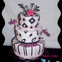 Black White And Pink Tier This is a three tier chocolate Carmel pecan cake iced with butter cream with fondant and chocolate accents