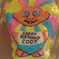 Troll Cake   My husband actually done this cake with BC frosting, the recipie for a better scratch white cake, and a wilton troll pan.