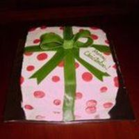 "Christmas Present   2-layer 8"" chocolate iced in buttercream with mmf accents and bow"