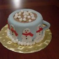 Hot Cocoa  Here's my attempt at a mug of hot cocoa. It's a 2-layer 6-inch french vanilla iced in buttercream, then covered with mmf. The...