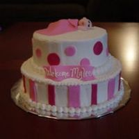"Pink Shower Cake 8"" and 6"" iced in buttercream with fondant accents, baby, and blanket"