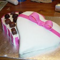 "Box Of Chocolates Thanks to those of you who have posted similar cakes for the ideas. The ""box"" is a strawberry heart shaped cake iced in..."