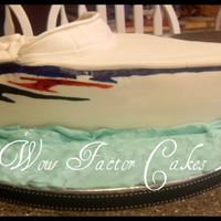 Baja Speedboat chocolate cake with vanilla buttercream and fondant. Painting on the side with americolors. Rice krispie treats used for the front of the...