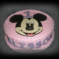 "Alisson's Mickey 12"" round with fondant layers to create mickey's face."