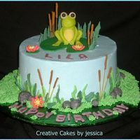 "Lila's Lil Frog   8"" round Chocolate cake w Vanilla Mousse. BC Frosting Fondant accents. Frog was made from tutorial on youtube from Donna Lane"