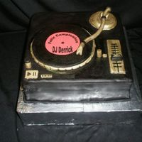 Derrick's Turntable 9x9 caramel cake with Dulce de leche filling chocolate frosting, fondant overlay. Got tons of inspiration from pics here and from Macsmom...